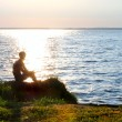 Fisher on a sunset — Stock Photo