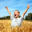 Kid in wheat field — Stock Photo
