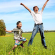 Royalty-Free Stock Photo: Teenager and kid jumping