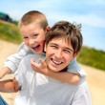 Happy teenager and kid — Stock Photo