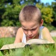 Child reads book — Stock Photo