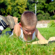 Stock Photo: Child reads book