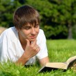 Stock Photo: Teenager reads book