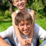Happy teenager and kid — Stock Photo #1331759