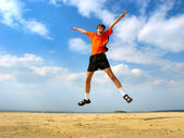 Happy teenager jumping — Stock Photo
