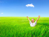 Happy kid in the field — Stock Photo