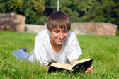 Teenager reads book — Stock Photo