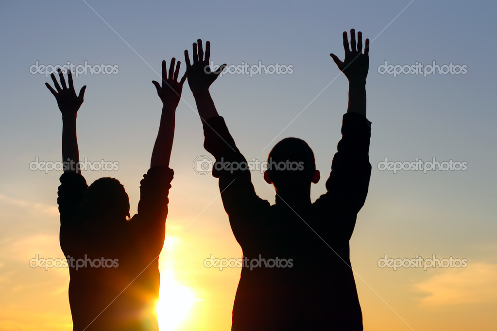 Young couple hands up silhouette — Foto Stock #1331193