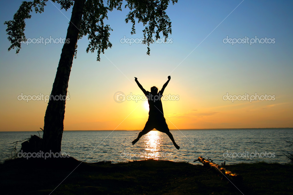Happy person jumping on the sunset sky background  — Stock Photo #1331275