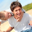 Happy teenager and kid — Stock Photo