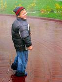 Kid in the rain — Stock Photo