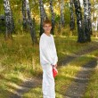 Boy in autumn forest — Stock Photo