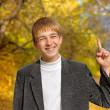 Stock Photo: Boy with finger up