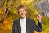 Boy with finger up — Stock Photo