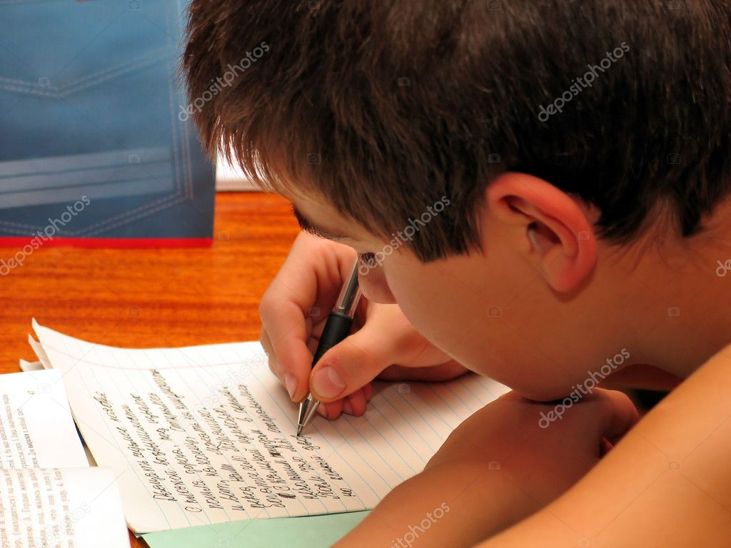 The schoolboy closely doing the homework   Stock Photo #1791580