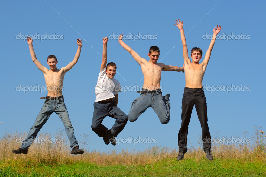 Happy smiling youth group of tennage boys jumping — Stock Photo #1791856