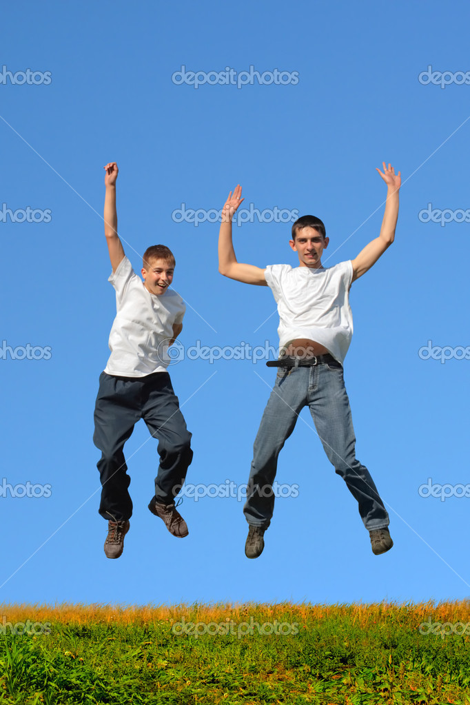 Happy smiling youth two teenage boys jumping — Stock Photo #1839054