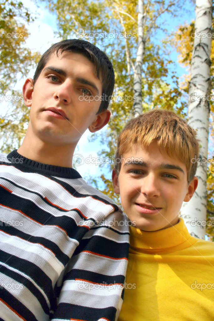 Two teenagers stand in autumn forest  Stock Photo #1945738