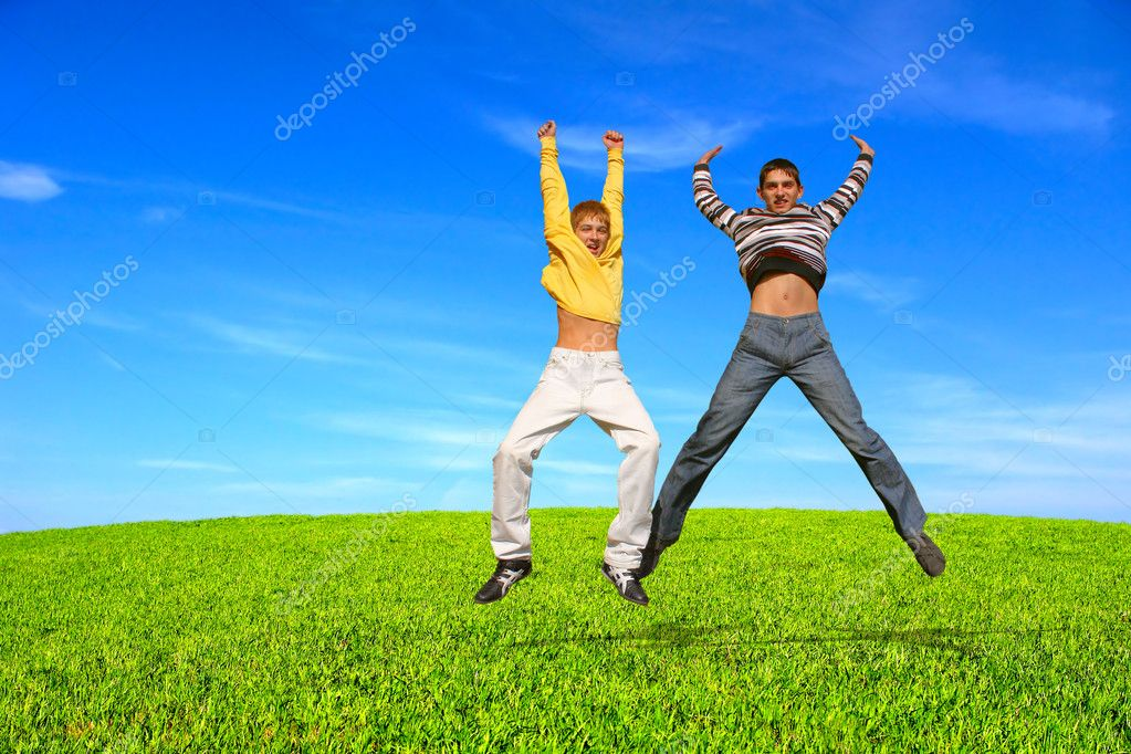 Happy smiling youth two teenage boys jumping — Stock Photo #1946544