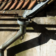 Old rain gutter with drainpipe - Stock Photo