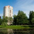 Stock Photo: City park with modern residential houses