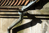 Old rain gutter with drainpipe — Stock Photo