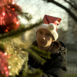 Man hiding behind the christmas tree — Stock Photo