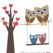 Owls family on the tree. — Stockvector