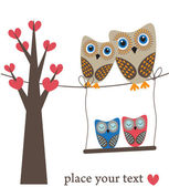 Owls family on the tree. — Stock Vector