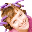 Stock Photo: Young pretty girl with hair curlers