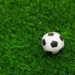 Stock Photo: Soccer balls on the grass