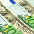 Stock Photo: Hundred euro and dollar banknotes