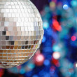 Disco ball against blurred background — Stock Photo