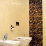 Luxury bathroom with toilet sink and bid — Stock Photo