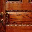 Door handle on the wooden door — Stock Photo #1305876