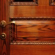 图库照片: Door handle on wooden door