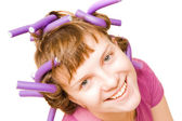 Young pretty girl with hair curlers — Stok fotoğraf