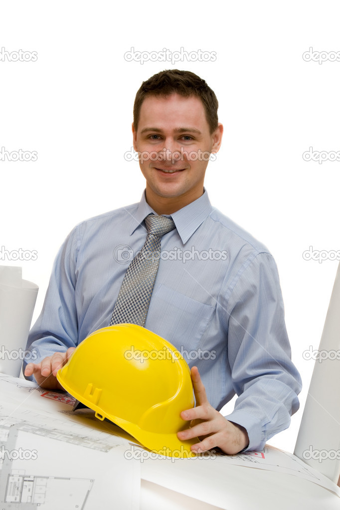 Handsome young architect at work with blueprints  Stock Photo #1305056