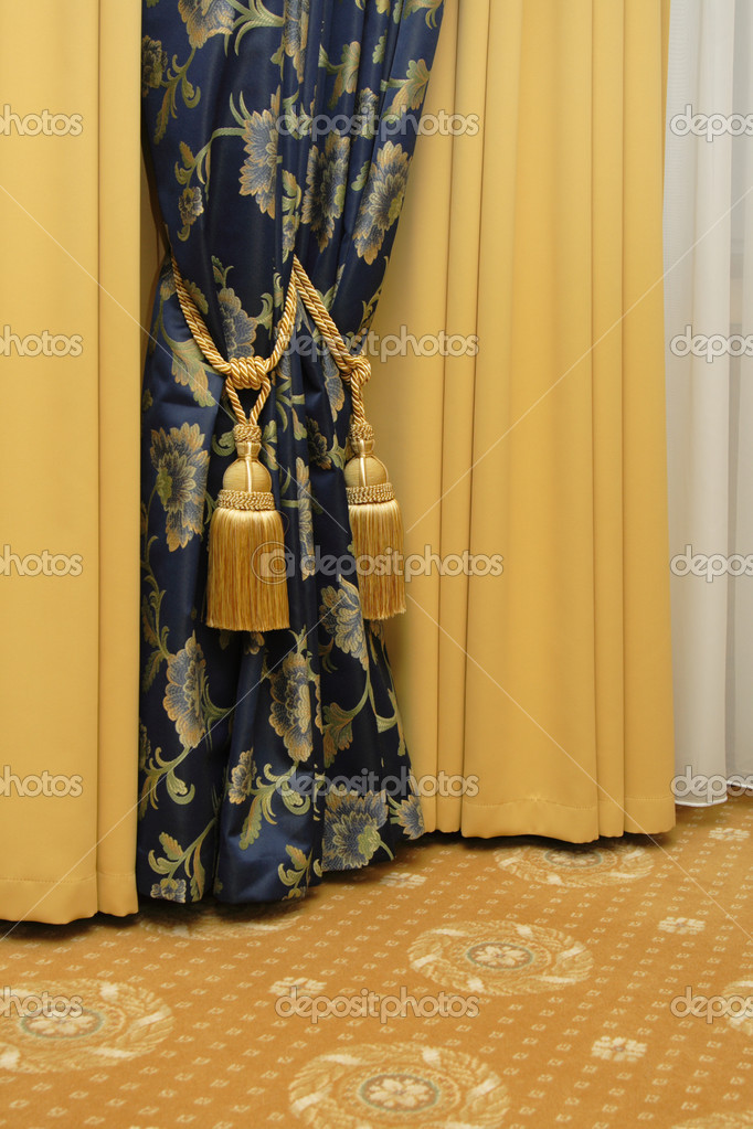 Dark blue curtain with tassel, gold blackout curtain — Stock Photo #1305830