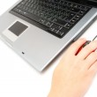 Computer and female hand — Stock Photo