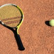图库照片: Tennis-racket with two balls