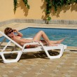 Young lady laying on beach chair — Stock Photo