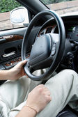 Driver holding steering wheel — Stock Photo