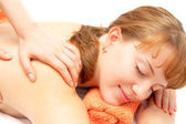 Young woman receiving back massage — Stock Photo