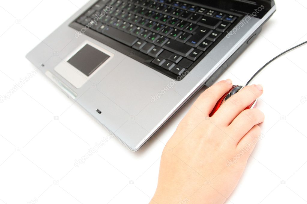 Female hand on mouse with notebook — Stock Photo #1401940