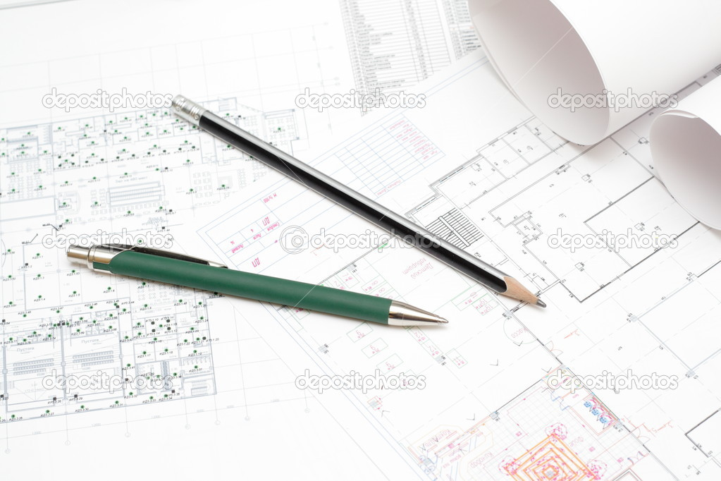 Rolled blueprints and architectural planes — Stock Photo #2109119