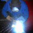 Arc welder with welding sparks — Stock Photo