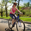Young lady driving bycicle - Foto de Stock