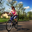 Stock Photo: Young lady driving a cycle