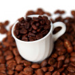 Cup with coffee beans — Photo